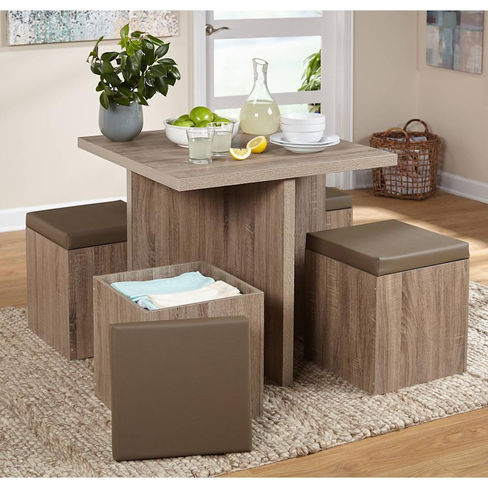 """<p>This <a href=""""https://www.popsugar.com/buy/5-Piece-Baxter-Dining-Set-419259?p_name=5-Piece%20Baxter%20Dining%20Set&retailer=walmart.com&pid=419259&price=180&evar1=casa%3Auk&evar9=46503576&evar98=https%3A%2F%2Fwww.popsugar.com%2Fhome%2Fphoto-gallery%2F46503576%2Fimage%2F46503706%2F5-Piece-Baxter-Dining-Set-Storage-Ottoman&list1=shopping%2Cfurniture%2Cwalmart%2Chome%20shopping&prop13=api&pdata=1"""" rel=""""nofollow"""" data-shoppable-link=""""1"""" target=""""_blank"""" class=""""ga-track"""" data-ga-category=""""Related"""" data-ga-label=""""https://www.walmart.com/ip/5-Piece-Baxter-Dining-Set-with-Storage-Ottoman-Multiple-Colors/41159848"""" data-ga-action=""""In-Line Links"""">5-Piece Baxter Dining Set </a> ($180-$296) is ideal if you're looking for extra storage space.</p>"""