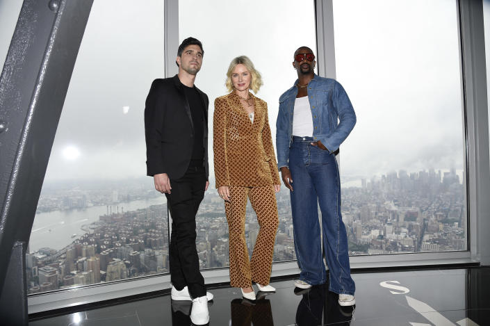 Afterpay co-CEO and co-founder Nick Molnar, from left, actor Naomi Watts and fashion designer LaQuan Smith participate in a New York Fashion Week kickoff event at the Empire State Building on Thursday, Sept. 9, 2021, in New York. (Photo by Evan Agostini/Invision/AP)