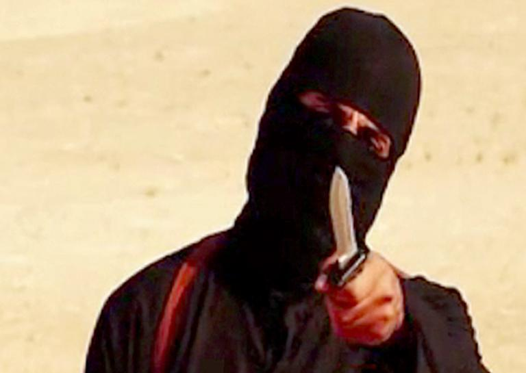 """Image grab from video released by the Islamic State and identified by SITE Intelligence Group on September 2, 2014, purportedly shows """"Jihadi John"""", the masked militant apparently responsible for the beheading of western hostages"""