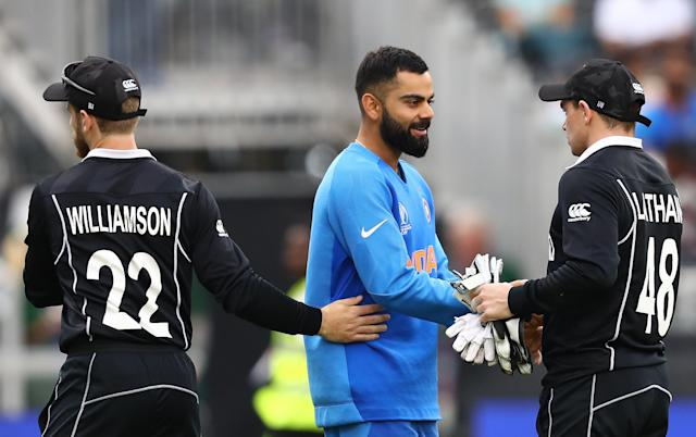 Kohli shakes hands with Tom Latham after New Zealand's semi-final victory (Photo by Michael Steele/Getty Images)