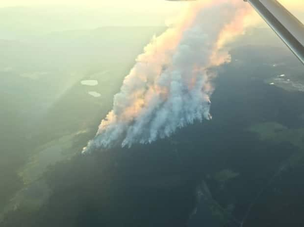 The Sparks Lake fire, about an hour northwest of Kamloops, B.C., has put 163 homes on evacuation order and another 298 homes on evacuation alert. The fire is estimated to be covering 36,000 hectares as of Sunday afternoon. (Twitter/B.C. Wildfire Service - image credit)