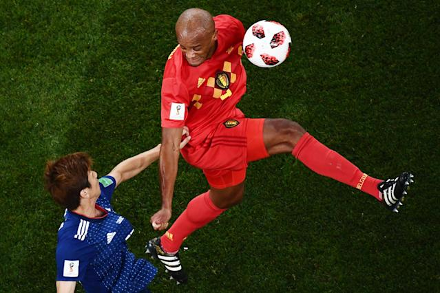 <p>Japan's forward Yuya Osako (L) challenges Belgium's defender Vincent Kompany during the Russia 2018 World Cup round of 16 football match between Belgium and Japan at the Rostov Arena in Rostov-On-Don on July 2, 2018. (Photo by Jewel SAMAD / AFP) </p>