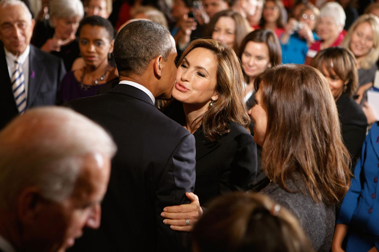 <p>Obama and Hargitay air-kiss during a 2010 Domestic Violence Awareness Month event at the White House.</p>