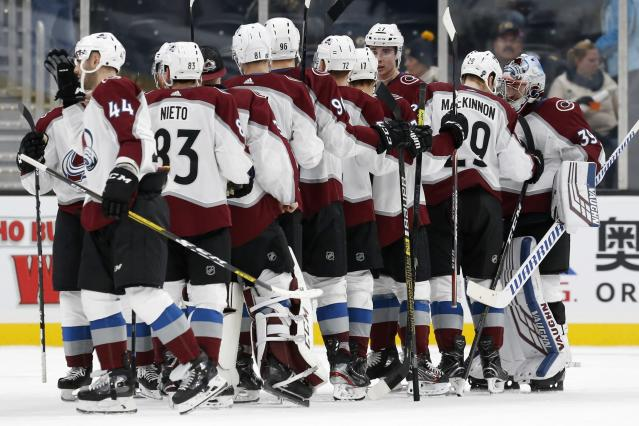 The Colorado Avalanche celebrate after defeating the Boston Bruins in an NHL hockey game in Boston, Saturday, Dec. 7, 2019. (AP Photo/Michael Dwyer)