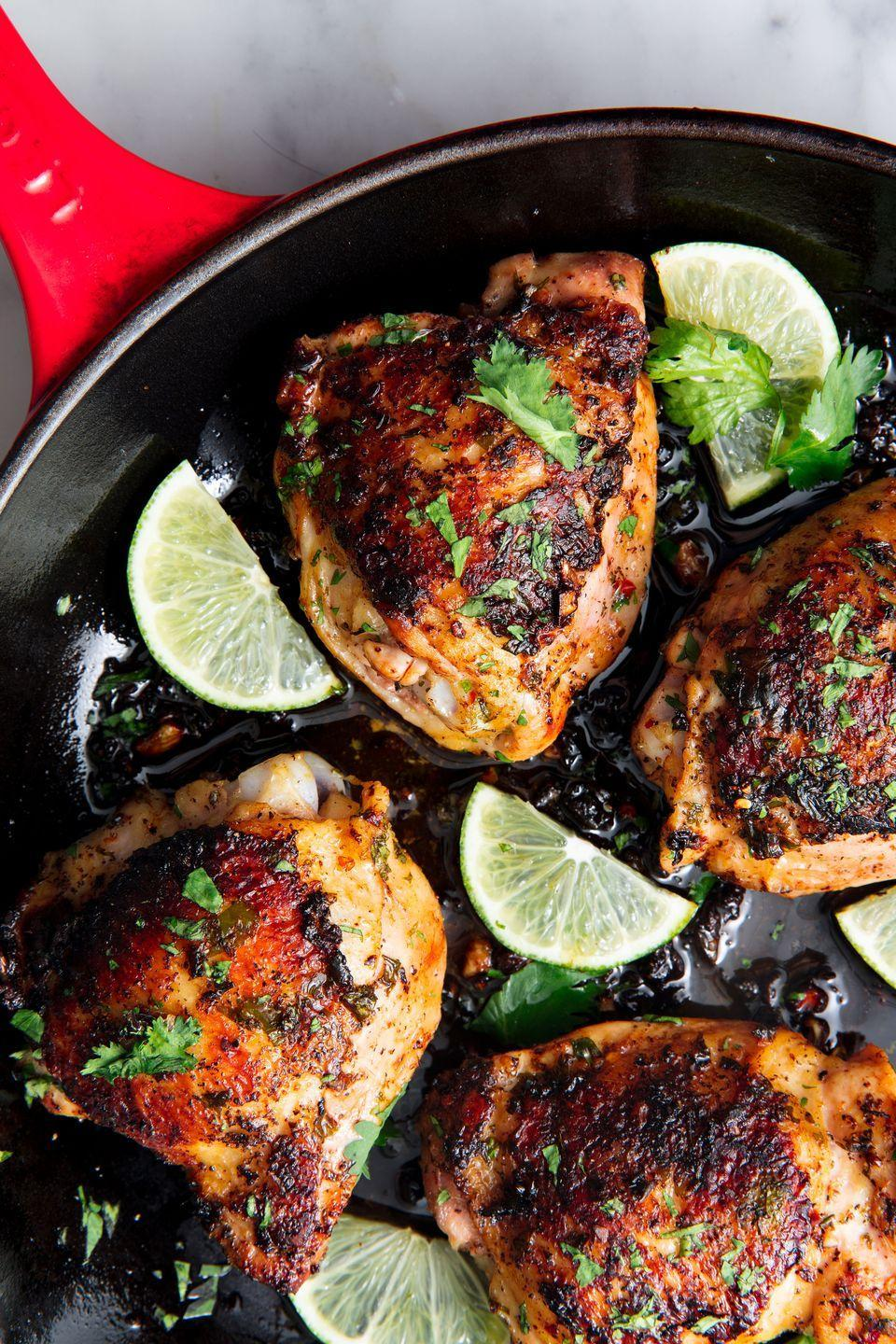 """<p>Pro tip: Chicken thighs almost always cost less than breasts. Plus, the flavor from the crispy skin is unbeatable. </p><p>Get the recipe from <a href=""""https://www.delish.com/cooking/recipe-ideas/a48247/cilantro-lime-chicken-recipe/"""" rel=""""nofollow noopener"""" target=""""_blank"""" data-ylk=""""slk:Delish"""" class=""""link rapid-noclick-resp"""">Delish</a>.</p>"""
