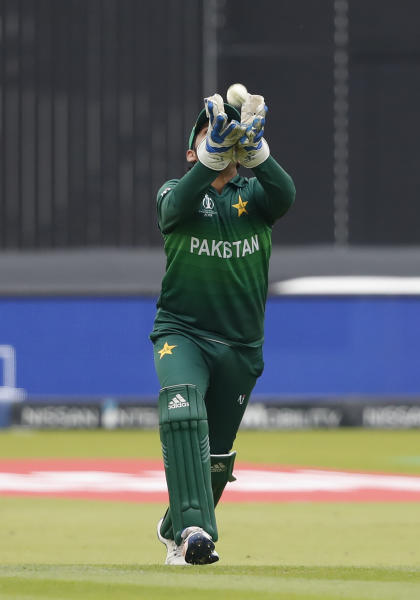 Pakistan's captain Sarfaraz Ahmed takes a catch to dismiss South Africa's captain Faf du Plessis during their Cricket World Cup match between Pakistan and South Africa at Lord's cricket ground in London, Sunday, June 23, 2019. (AP Photo/Alastair Grant)