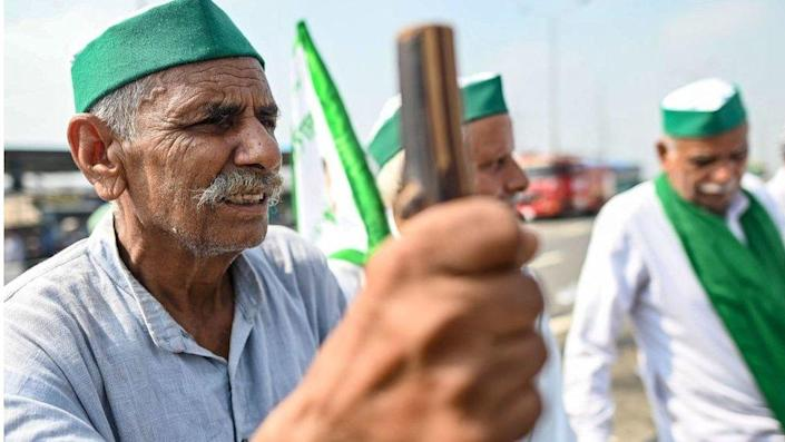 Farmers gather at the protest venue in Gazipur Delhi-Uttar Pradesh border during a nationwide strike called by the farmers as they continue to protest against the central government's agricultural reforms in Ghaziabad on September 27, 2021.