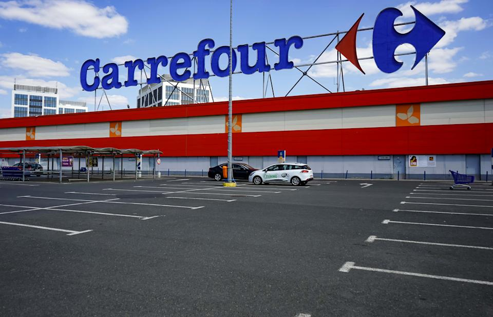 Bucharest, Romania - April 23, 2020: Empty parking lot of French multinational retailer Carrefour is seen at the Orhideea Shopping Center in Bucharest. Romania is in lockdown due to coronavirus.