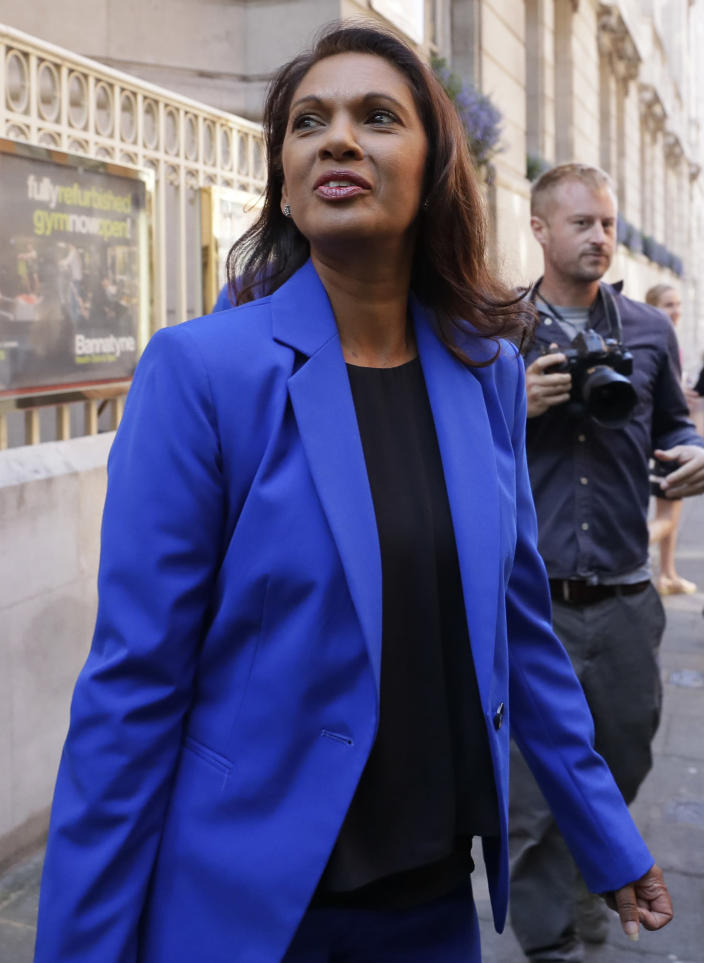 Campaigner Gina Miller leaves Millbank studios in London, Thursday, Aug. 29, 2019. Political opposition to Prime Minister Boris Johnson's move to suspend Parliament is crystalizing, with protests around Britain and a petition to block the move gaining more than 1 million signatures. (AP Photo/Kirsty Wigglesworth)