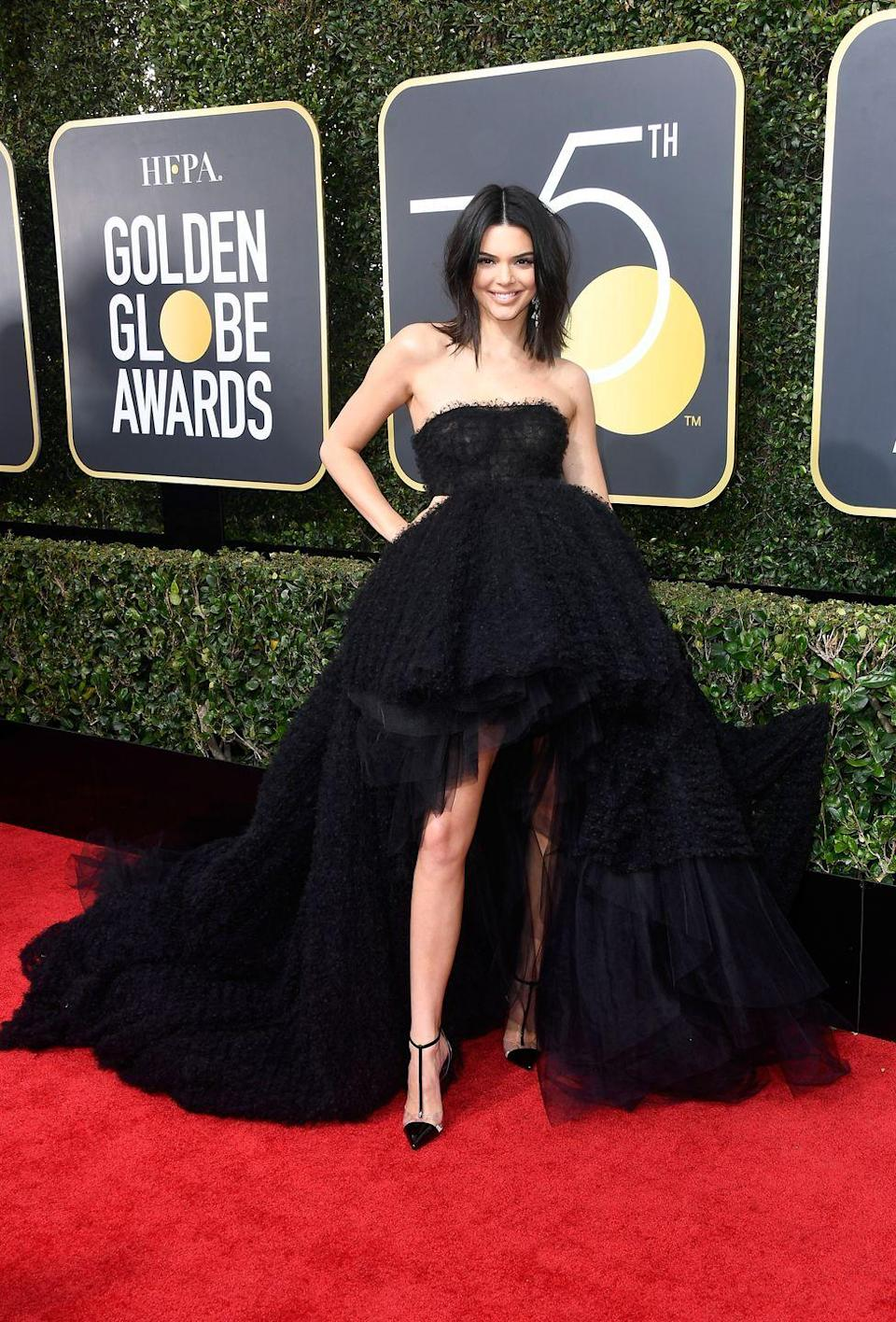 <p>The top model made her Golden Globes debut last year, and made quite a statement in this black mullet-hem Giambattista Valli gown to show off her famously-long legs. </p>