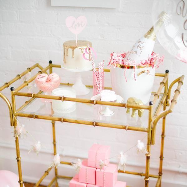 "<p>For that special night, there's no better vessel for all of your sweets—and the Champagne, of course—than a golden-hued bar cart.</p><p>Via <em><a href=""https://mintwoodhome.com/"" rel=""nofollow noopener"" target=""_blank"" data-ylk=""slk:Mintwood Home"" class=""link rapid-noclick-resp"">Mintwood Home</a></em></p><p><a class=""link rapid-noclick-resp"" href=""https://www.target.com/p/metal-wood-and-leather-bar-cart-gold-threshold/-/A-50746401"" rel=""nofollow noopener"" target=""_blank"" data-ylk=""slk:GET THE LOOK"">GET THE LOOK</a></p><p> <em>Gold Bar Cart, Target, $150</em></p>"