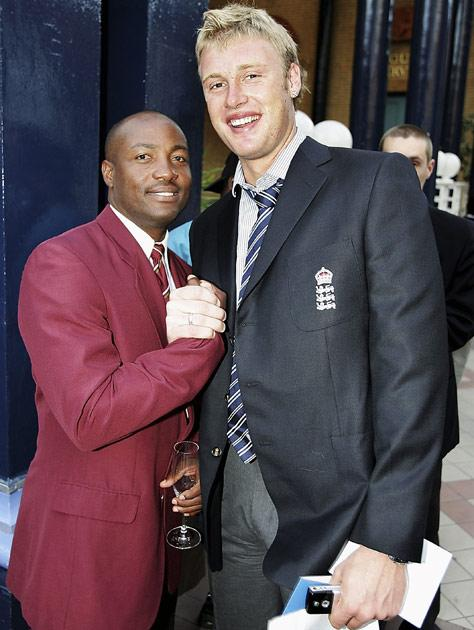 LONDON - SEPTEMBER 7:  Andrew Flintoff (R) of England and  West Indies captain Brian Lara share a joke during the ICC Awards 2004 at Alexandra Palace on September 7, 2004 in London, England. (Photo by Clive Mason/Getty Images)