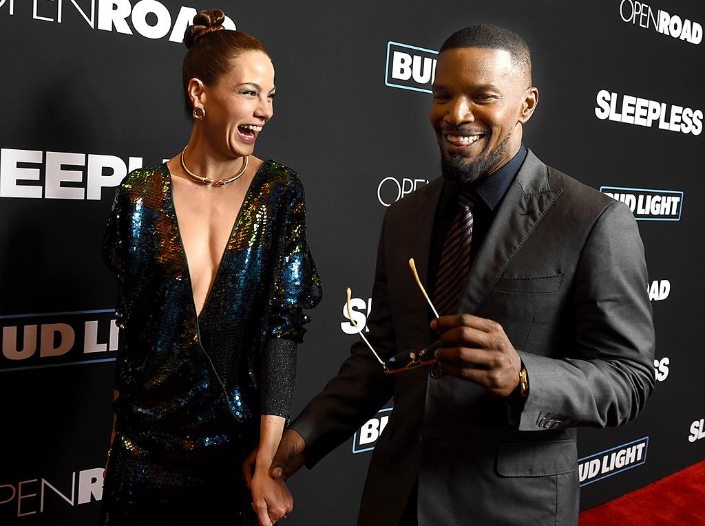 """<p>Jamie Foxx and Michelle Monaghan, who co-star in the new movie <i>Sleepless</i>, shared a laugh on the red carpet at the flick's premiere in L.A. We imagine it went something like this: """"Isn't it fabulous being a movie star?"""" """"Yes, yes it is!"""" (Photo: KevinWinter/Getty Images) </p>"""