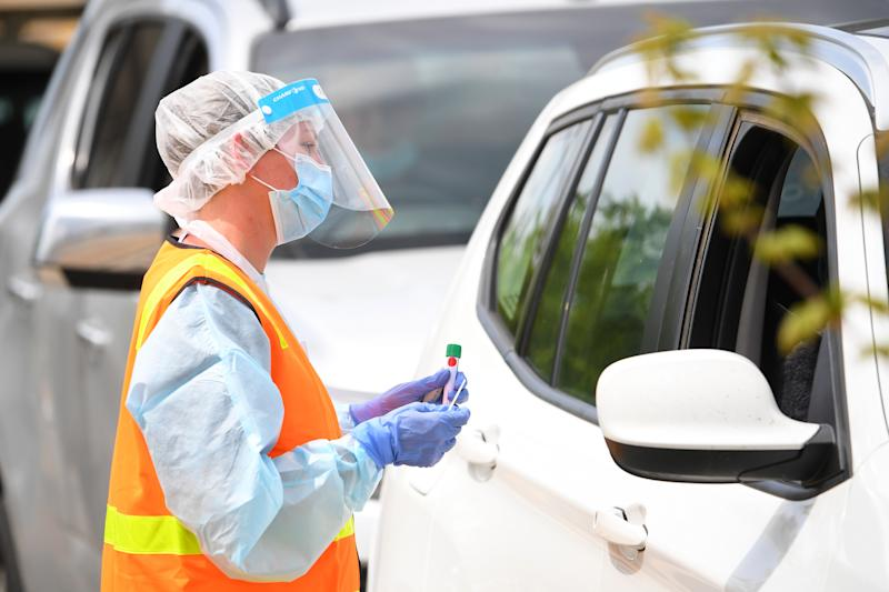 Healthcare workers seen at a drive-through Covid-19 testing facility in Shepparton.