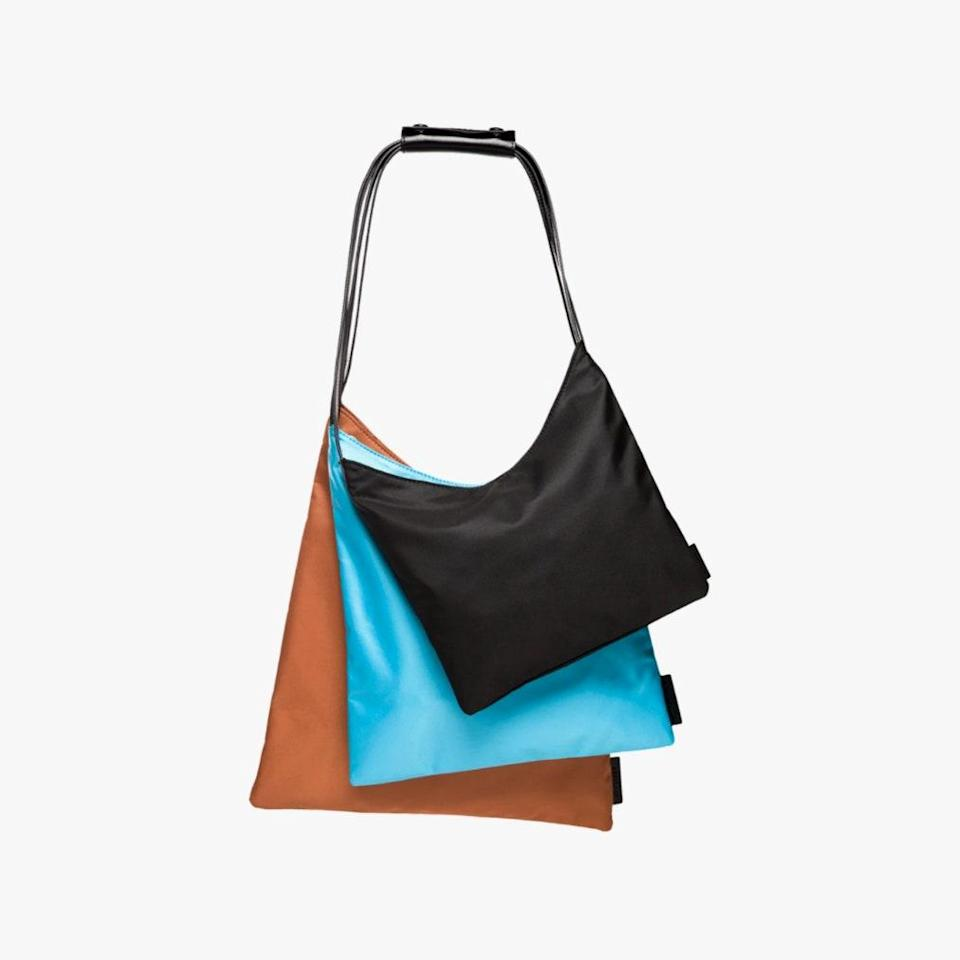 """All sale items on Bandier are an additional 30% off through Memorial Day. $195, BANDIER. <a href=""""https://www.bandier.com/collections/sale/products/multi-pouch-black?variant=32164149100578"""" rel=""""nofollow noopener"""" target=""""_blank"""" data-ylk=""""slk:Get it now!"""" class=""""link rapid-noclick-resp"""">Get it now!</a>"""