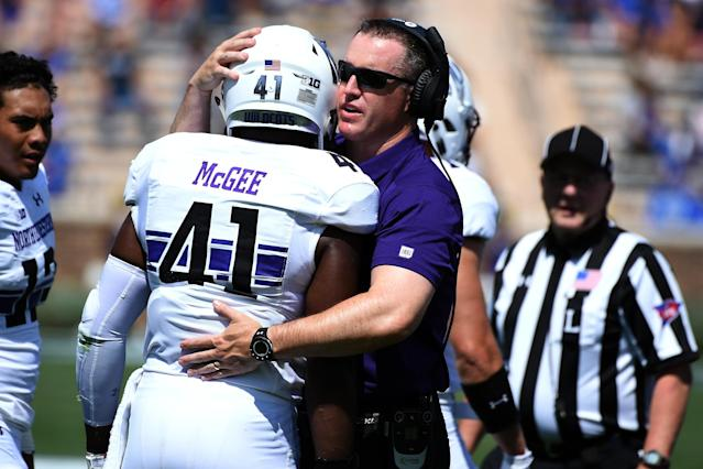 "DURHAM, NC – SEPTEMBER 09: Head coach Pat Fitzgerald of the <a class=""link rapid-noclick-resp"" href=""/ncaab/teams/nbd/"" data-ylk=""slk:Northwestern Wildcats"">Northwestern Wildcats</a> talks with Jared McGee #41 following a targeting call and ejection on McGee during their game against the <a class=""link rapid-noclick-resp"" href=""/ncaab/teams/dau/"" data-ylk=""slk:Duke Blue Devils"">Duke Blue Devils</a> at Wallace Wade Stadium on September 9, 2017 in Durham, North Carolina. (Photo by Lance King/Getty Images)"