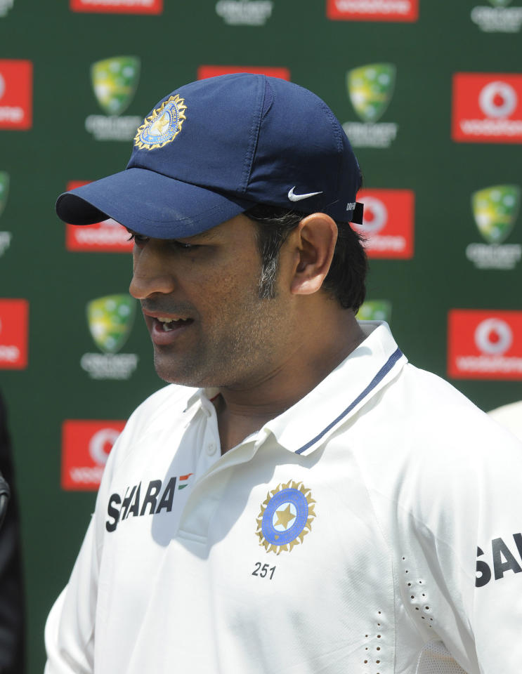 India's cricket team captain MS Dhoni reacts after his team was defeated by Australia in the cricket test match in Adelaide, Australia, Saturday, Jan. 28, 2012. (AP Photo/David Mariuz)