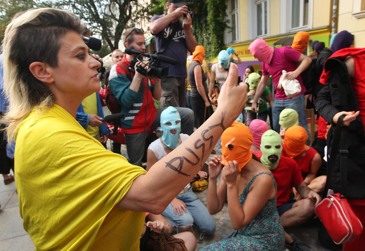 Canadian musician and performance artist Peaches, left, talks to actors wearing masks during the recording of a video of in support of members of the feminist punk group Pussy Riot in Berlin, Germany, Wednesday, Aug. 8, 2012. Prosecutors in Russia on Tuesday called for three-year prison sentences for feminist punk rockers who gave an impromptu performance in Moscow's main cathedral to call for an end to Vladimir Putin's rule, in a case that has caused international outrage and split Russian society. (AP Photo/dapd/Adam Berry)