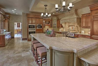 The main kitchen offers everything a chef needs, and is located adjacent to a fireplace lounge area and family room. Another kitchen is located on the lower living level. NewJerseyLuxuryAuction.com.