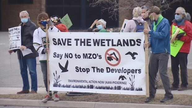 Pickering residents and environmentalists protested on Thursday against the controversial development on provincially protected Lower Duffins Creek wetland.  (CBC - image credit)