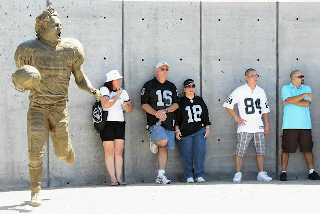 GLENDALE, AZ - SEPTEMBER 26: Fans of the Oakland Raiders stand near the Pat Tillman statue before the NFL game against the Arizona Cardinals at the University of Phoenix Stadium on September 26, 2010 in Glendale, Arizona. (Photo by Christian Petersen/Getty Images)