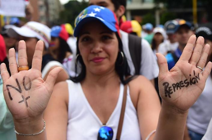 Led by opposition leaders and Lilian Tintori, wife of jailed opposition leader Leopoldo Lopez, thousands of women marched through Caracas to pressure President Nicolas Maduro (AFP Photo/RONALDO SCHEMIDT)