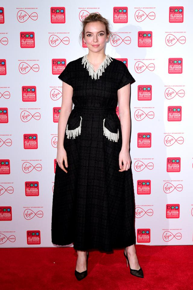 <p>On March 15, 'Killing Eve' actress Jodie Comer further cemented her fashion status in a voluminous checked dress. The actress finished the ensemble with sheer shoes and a lick of minimal make-up – a far cry from Villanelle's killer wardrobe. <em>[Photo: Getty]</em> </p>