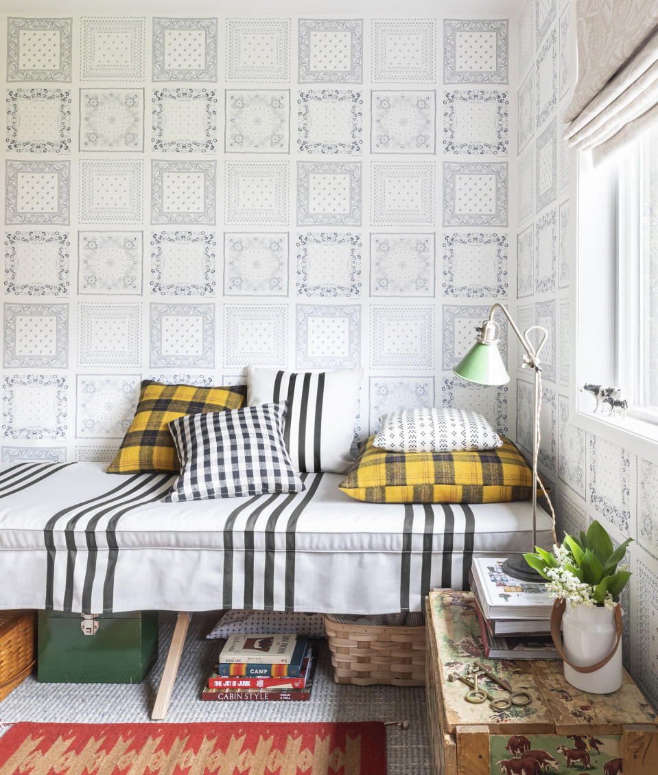 This image released by Portland Oregon-based interior designer Max Humphrey shows a room with a wallpaper design inspired by bandanas. (Christopher Dibble via AP)