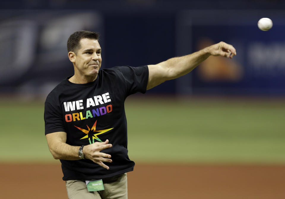 Bill Bean, MLB's vice president of Social Responsibility and Inclusion, throws out the ceremonial first pitch before a baseball game between the Tampa Bay Rays and the San Francisco Giants, Friday, June 17, 2016, in St. Petersburg, Fla. (AP Photo/Chris O'Meara)