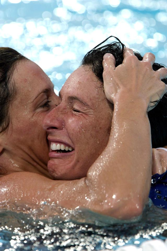 The Italian players celebrate their win during the Women's Water Polo Gold Medal match at the Olympic Aquatic Centre on August 26, 2004 during the Athens 2004 Olympic Games. (Photo by Chris Ivin/Getty Images)