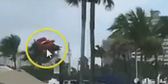 3 hurt as waterspout sends beach bouncy castle into the air (video)