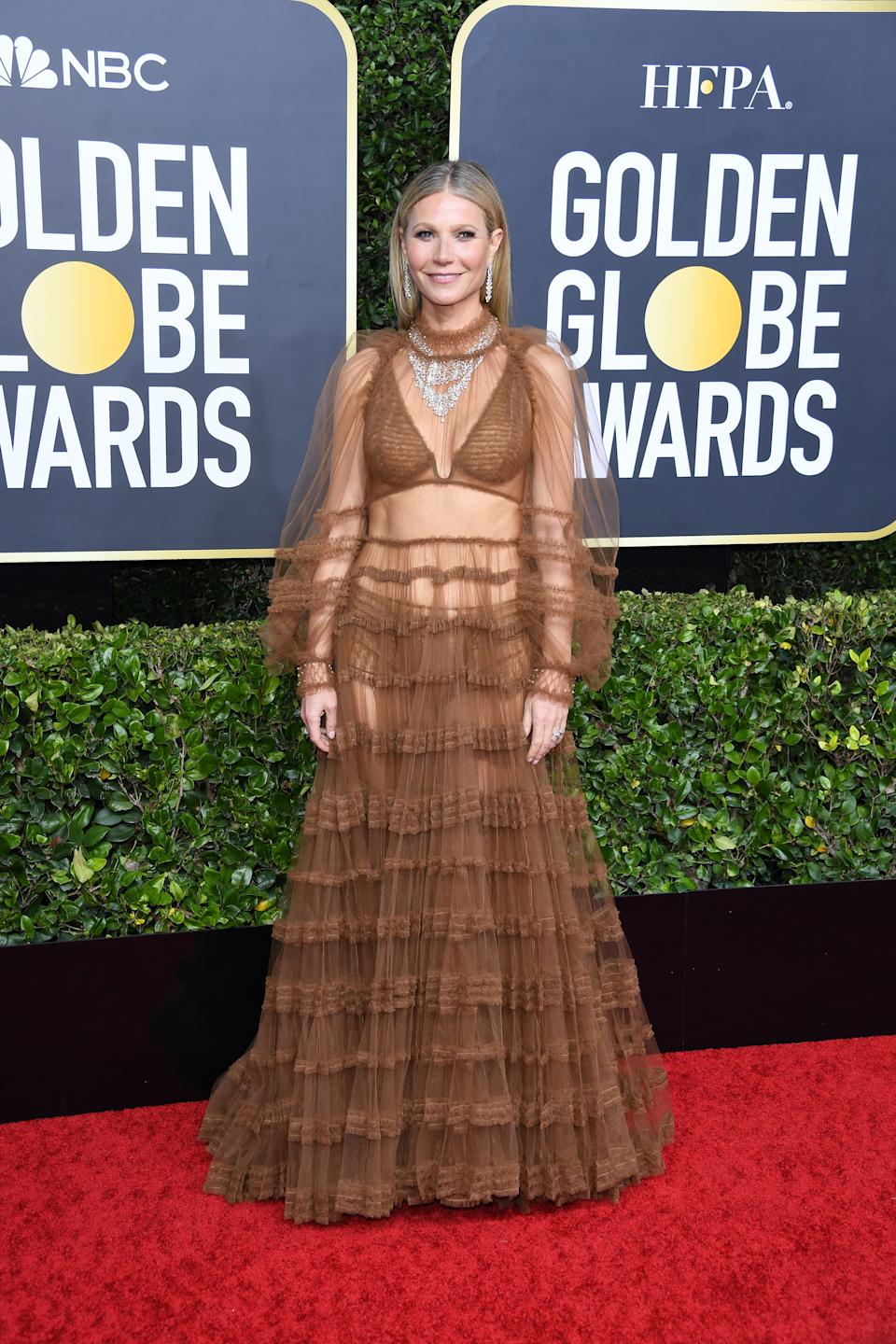 Gwyneth Paltrow wore a semi-sheer dress, showcasing her enviable abs, to the Golden Globes 2020 [Photo: Getty]