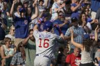 Chicago Cubs' Patrick Wisdom celebrates after hitting a three-run home run during the eighth inning of a baseball game against the Milwaukee Brewers Sunday, Sept. 19, 2021, in Milwaukee. (AP Photo/Morry Gash)