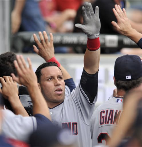 Cleveland Indians' Asdrubal Cabrera celebrates with teammates in the dugout after scoring on a Jason Kipnis double during the second inning of the first game of a doubleheader baseball game against the Chicago White Sox in Chicago, Friday, June 28, 2013. (AP Photo/Paul Beaty)