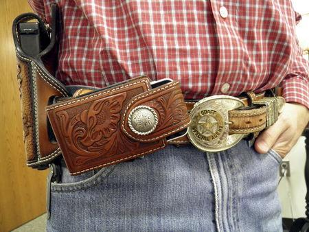 The Investigative Services Unit of the Oklahoma Department of Agriculture, Food, and Forestry (ODAFF) Special Agent Ricky Rushing wears a hand-tooled belt and holster at the agency's headquarters in Oklahoma City, Oklahoma September 30, 2015. REUTERS/Jon Herskovitz
