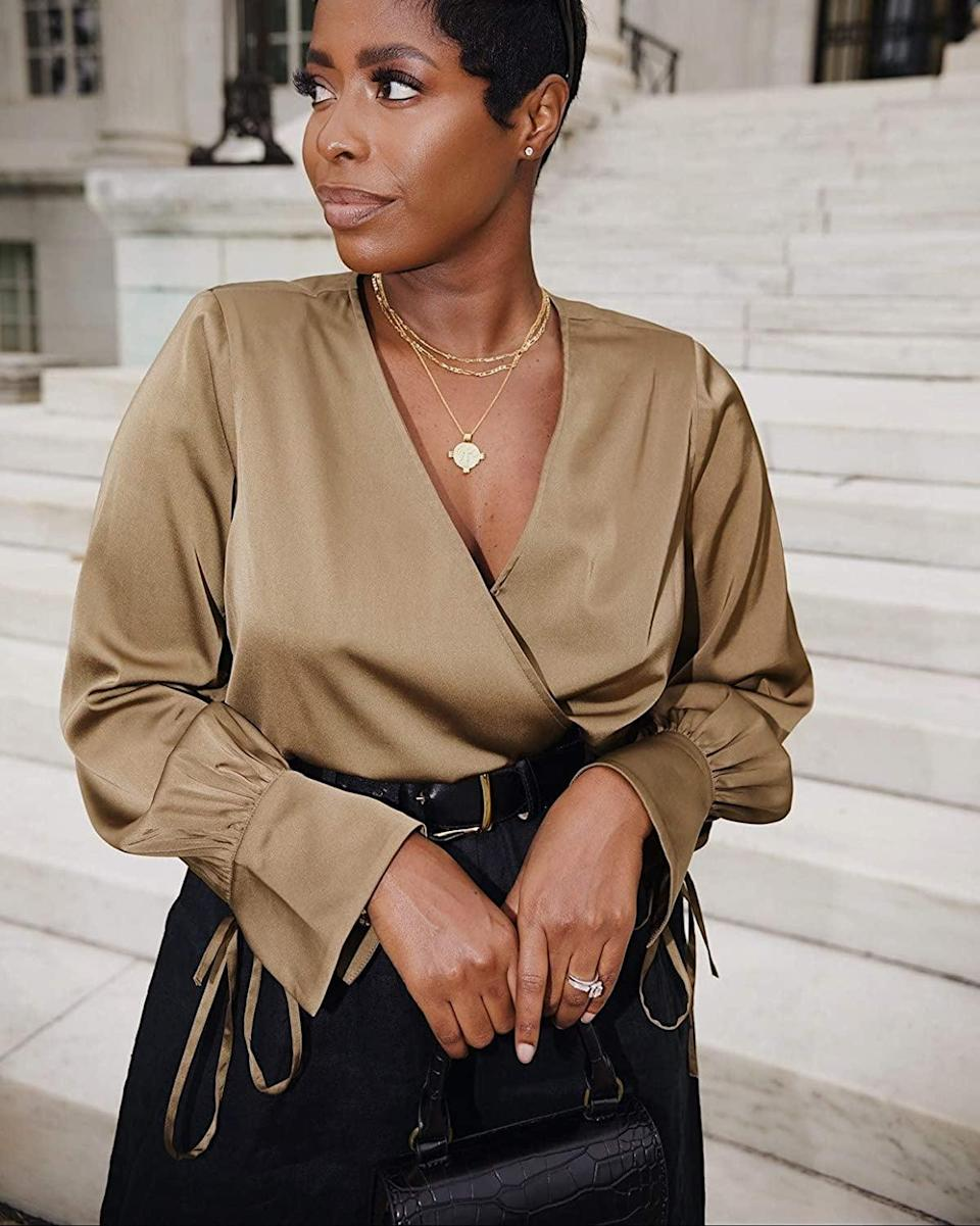 <p><span>The Drop Dark Olive Wrap-Effect Tie-Cuff Top by @highlowluxxe</span> ($50)</p>