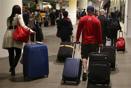 Passengers walk through Los Angeles International Airport