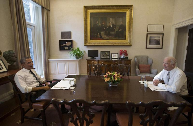 President Barack Obama and Vice President Joe Biden talk during a photo-op as they meet for lunch in the Private Dining Room of the White House in Washington, Wednesday, Jan. 8, 2014. (AP Photo/Carolyn Kaster)