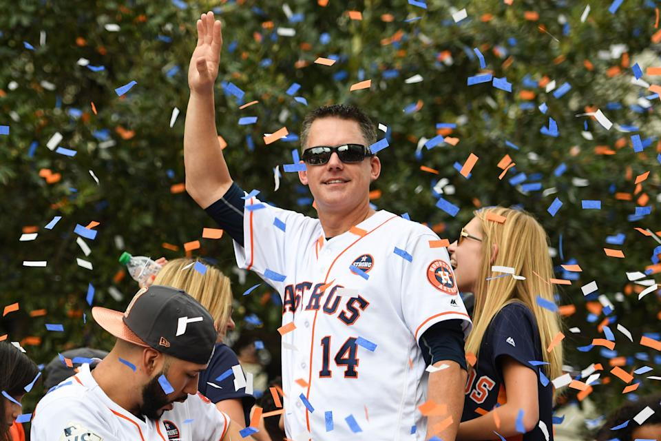Houston Astros manager A.J. Hinch greets fans during the World Series championship parade and rally for the Houston Astros in downtown Houston, Nov. 3, 2017.
