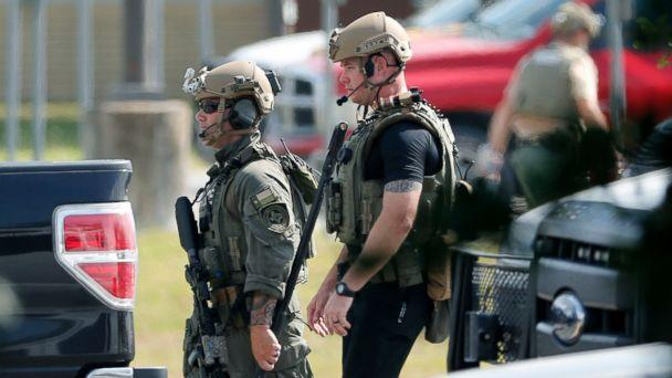 PHOTO: Police officers in tactical gear move through the scene at Santa Fe High School after a shooting on May 18, 2018, in Santa Fe, Texas. (Kevin M. Cox /The Galveston County Daily News via AP)