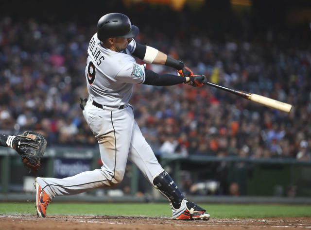 Miami Marlins' Miguel Rojas swings for a two run single off San Francisco Giants' Andrew Suarez in the fifth inning of a baseball game Monday, June 18, 2018, in San Francisco. (AP Photo/Ben Margot)