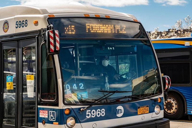 A Metropolitan Transportation Authority (MTA) driver wears a protective mask while driving a bus in the Bronx borough of New York, U.S., on Thursday, April 2, 2020.