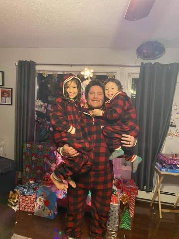 Kelly McLeod, in a photo posted to his official campaign Facebook page, poses with his children. McLeod has been elected the new president of the Nihtat Gwich'in Council, according to preliminary results. (Kelly McLeod for Nihtat President 2021/Facebook - image credit)