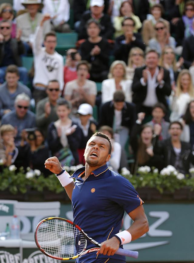 France's Jo-Wilfried Tsonga reacts as he defeats Poland's Jerzy Janowicz during the third round match of the French Open tennis tournament at the Roland Garros stadium, in Paris, France, Friday, May 30, 2014. Tsonga won 6-4, 6-4, 6-3. (AP Photo/Michel Spingler)
