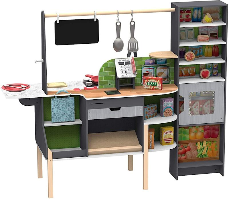 """You're going to need some space for <a href=""""https://amzn.to/2ZWKBGJ"""" target=""""_blank"""" rel=""""noopener noreferrer"""">this kitchen and market</a>, which comes fully equipped with a self-checkout,working smart scanner andstorage shelves. Kids can play with Amazon's Alexa and choose between five different modes. <a href=""""https://amzn.to/2ZWKBGJ"""" target=""""_blank"""" rel=""""noopener noreferrer"""">Find it for $300 at Amazon</a>."""
