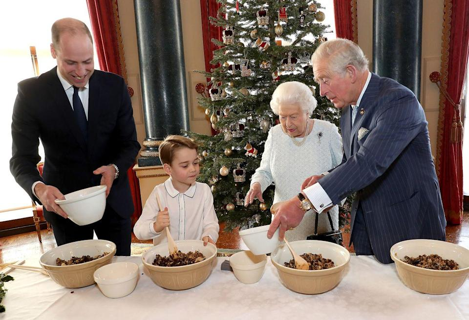 <p>To round out the year and boost the holiday cheer, Buckingham palace released a photograph of Queen Elizabeth and her heirs, Price Charles, Prince William, and Prince George preparing special Christmas puddings together in the Music Room at Buckingham Palace. The photo was part of the launch of the Royal British Legion's Together at Christmas Initiative in London. </p>
