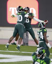 Michigan State's Michael Dowell, left, Kalon Gervin, center, and Tre Person, right, celebrate Gervin's fumble recovery for a touchdown at the conclusion of an NCAA college football game against Northwestern, Saturday, Nov. 28, 2020, in East Lansing, Mich. (AP Photo/Al Goldis)