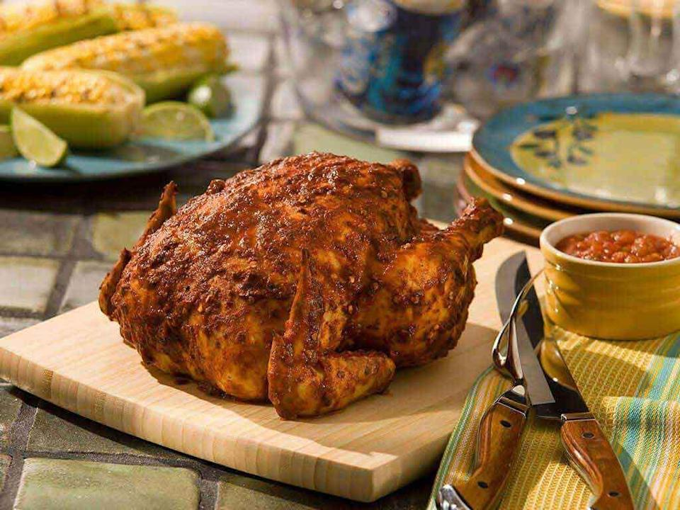 """<p>Not using enough seasoning is a <a href=""""https://www.thedailymeal.com/cook/grilled-chicken-mistakes-gallery?referrer=yahoo&category=beauty_food&include_utm=1&utm_medium=referral&utm_source=yahoo&utm_campaign=feed"""" rel=""""nofollow noopener"""" target=""""_blank"""" data-ylk=""""slk:mistake you don't want to make when grilling chicken"""" class=""""link rapid-noclick-resp"""">mistake you don't want to make when grilling chicken</a>. With this recipe for beer can chicken, you'll have plenty of flavor after adding a chipotle pepper rub.</p> <p><a href=""""https://www.thedailymeal.com/best-recipes/beer-can-chicken-chipotle-rub?referrer=yahoo&category=beauty_food&include_utm=1&utm_medium=referral&utm_source=yahoo&utm_campaign=feed"""" rel=""""nofollow noopener"""" target=""""_blank"""" data-ylk=""""slk:For the Chipotle-Rubbed Beer Can Chicken recipe, click here."""" class=""""link rapid-noclick-resp"""">For the Chipotle-Rubbed Beer Can Chicken recipe, click here.</a></p>"""