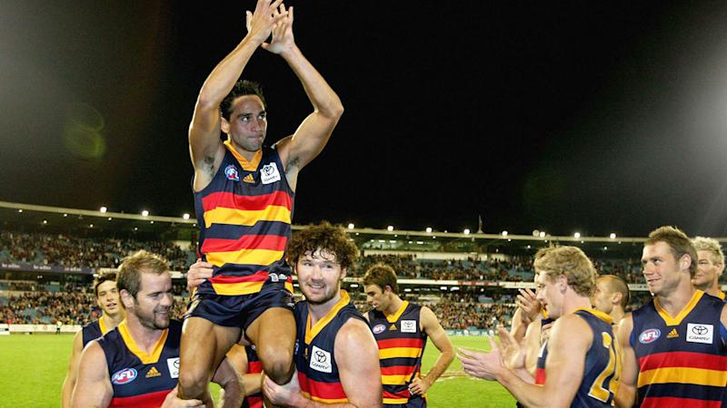 Seen here, Andrew McLeod is chaired off the ground in 2006 by Crows teammates.