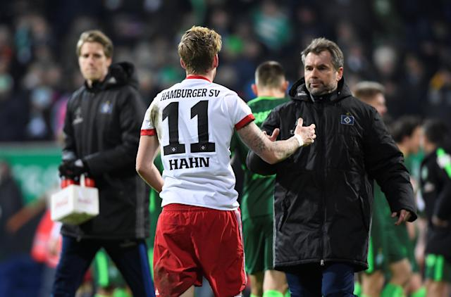 Soccer Football - Bundesliga - Werder Bremen vs Hamburger SV - Weser-Stadion, Bremen, Germany - February 24, 2018 Hamburg coach Bernd Hollerbach shakes hands with Andre Hahn at the end of the match REUTERS/Fabian Bimmer DFL RULES TO LIMIT THE ONLINE USAGE DURING MATCH TIME TO 15 PICTURES PER GAME. IMAGE SEQUENCES TO SIMULATE VIDEO IS NOT ALLOWED AT ANY TIME. FOR FURTHER QUERIES PLEASE CONTACT DFL DIRECTLY AT + 49 69 650050